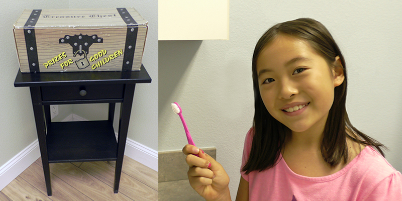 prize=box-and-young-girl-in-pink-shirt-holidng-toothbrush