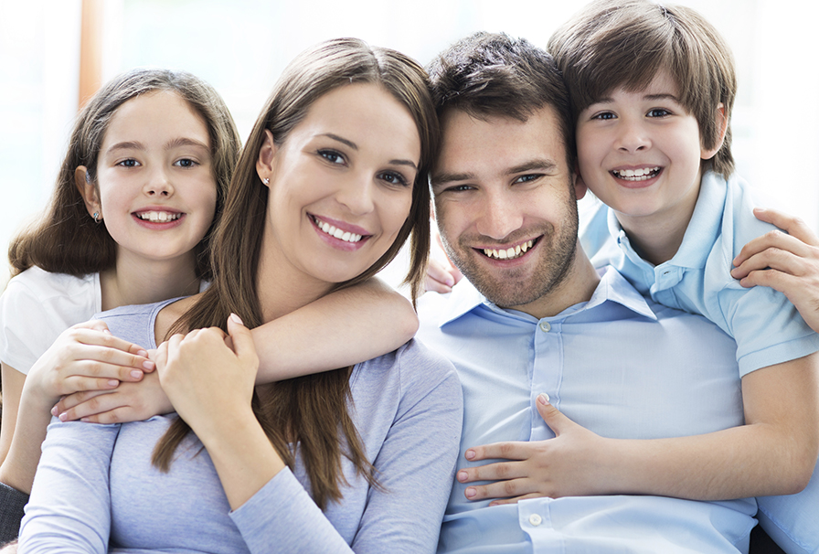 daughter-mother-father-and-son-smiling