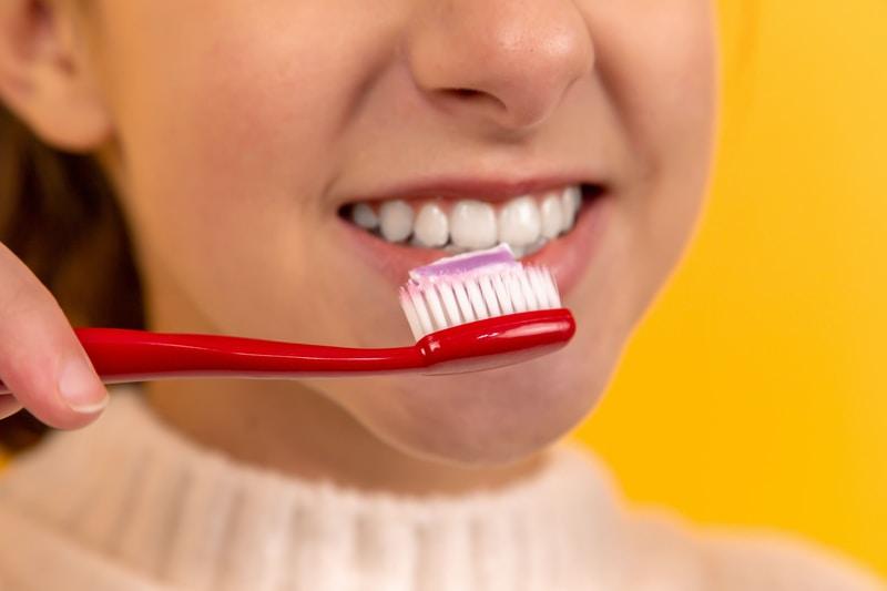 young-girl-brushing-teeth